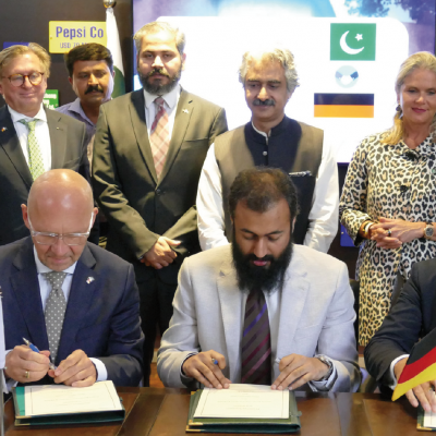 Bavarian Business Delegation to Pakistan, April 2019. Jahanzeb Burana, Chief Executive Officer, Punjab Board of Investment and Trade, signs Agreement with Klaus Dittrich, CEO, Messe Muenchen (Munich Trade Fair) and Honorary Consul Dr. Pantelis Christian Poetis, President, G.A.T.E. to Pakistan.  Also in the picture: Mafaz Ahsan, Research Associate, Punjab Board of Investment & Trade, Dr. Michael Kerkloh, CEO, Munich Airport, Rana Waqas, Additional Director, Head of Transactions Department, Punjab Board of Investment & Trade, Mian Aslam Iqbal, Minister for Industries, Commerce & Investment Department, Patricia Poetis, MD, Life Fund Equity Invest, Philomena Poetis, MD, Munich Members