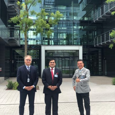 Dirk Dörrschuck, Vice President Middle East & Africa Region, Rohde & Schwarz International GmbH, with H.E. Ambassador Dr. Mohammad Faisal and Honorary Consul Dr. Pantelis Christian Poetis in-front of the Rohde & Schwarz building in Munich ©HonorarkonsulatPakistanMUC
